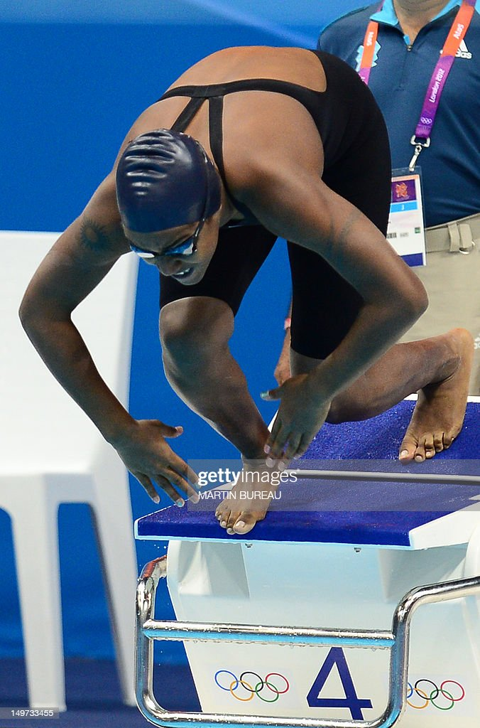 Marshall Islands' Ann-Marie Hepler takes the start of the women's 50m freestyle heats during the swimming event at the London 2012 Olympic Games on August 3, 2012 in London.