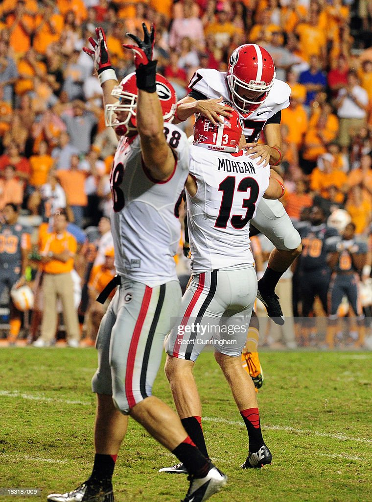 Marshall Morgan #13 of the Georgia Bulldogs celebrates with Adam Erickson #97 after kicking the game-winning field goal in overtime against the Tennessee Volunteers at Neyland Stadium on October 5, 2013 in Knoxville, Tennessee.