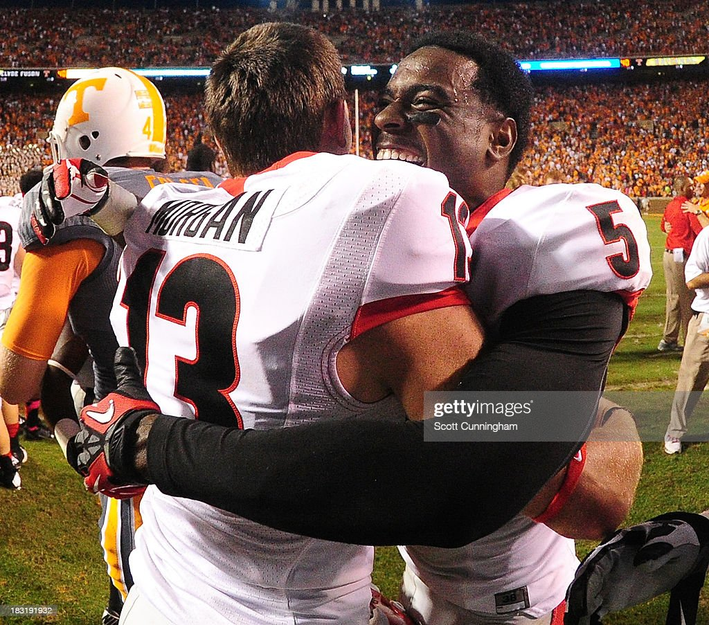 Marshall Morgan #13 of the Georgia Bulldogs celebrates with Damian Swann #5 after kicking the game-winning field goal in overtime against the Tennessee Volunteers at Neyland Stadium on October 5, 2013 in Knoxville, Tennessee.