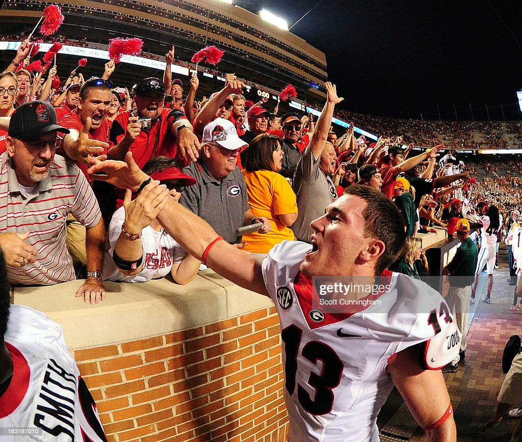 Marshall Morgan #13 of the Georgia Bulldogs celebrates with fans after kicking the game-winning field goal in overtime against the Tennessee Volunteers at Neyland Stadium on October 5, 2013 in Knoxville, Tennessee.