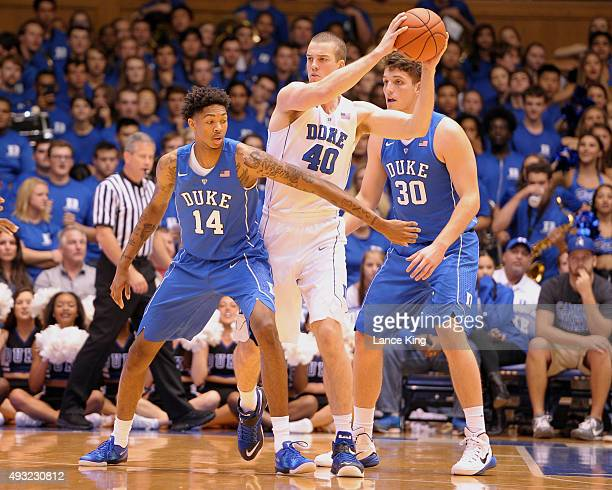 Marshall Plumlee controls the ball against Brandon Ingram and Antonio Vrankovic of the Duke Blue Devils during Countdown to Craziness at Cameron...