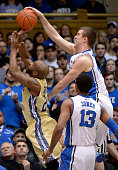Marshall Plumlee of the Duke Blue Devils blocks a shot by Solomon Poole of the Georgia Tech Yellow Jackets during their game at Cameron Indoor...