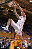 Marshall Plumlee of the Duke Blue Devils dunks against the Long Beach State 49ers at Cameron Indoor Stadium on December 30 2015 in Durham North...