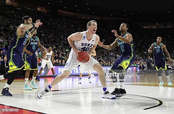 Marshall Plumlee of the Duke Blue Devils handles the ball in the second half against the North CarolinaWilmington Seahawks during the first round of...