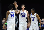 Marshall Plumlee of the Duke Blue Devils high fives Brandon Ingram in the second half of their game against the North CarolinaWilmington Seahawks...