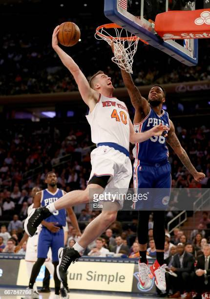 Marshall Plumlee of the New York Knicks dunks as Shawn Long of the Philadelphia 76ers defends at Madison Square Garden on April 12 2017 in New York...
