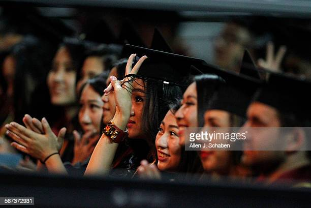 Marshall School of Business graduates cheer after listening to the commencement address by Tesla/SpaceX founder Elon Musk and student speaker Kiara...