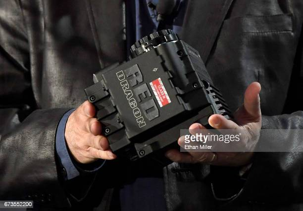 Marshall Space Flight Center Imagery Experts Program Manager Rodney Grubbs displays a RED Epic Dragon camera that was once on the International Space...