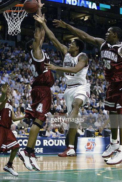 Marshall Strickland of Indiana shoots a layup against Kenny Walker of Alabama during the first round of the NCAA Tournament on March 21 2003 at the...