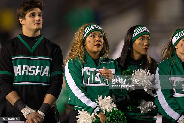 Marshall Thundering Herd cheerleader with tears streaming down her cheek as a video saluting the 1970 team that was killed in a plane crash is shown...