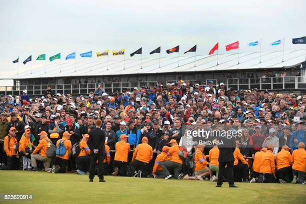 Marshalls keep spectators back from the 18th green during the final round of the 146th Open Championship at Royal Birkdale on July 23 2017 in...