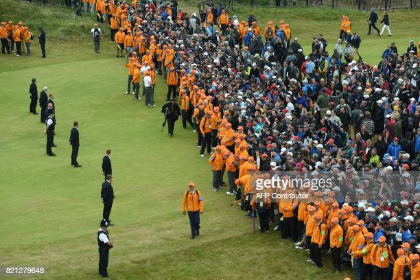 Marshalls keep spectators back from the 18th green during the presentations on day four of the 2017 Open Golf Championship at Royal Birkdale golf...