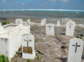 Marshallsenvironmentclimatewarming by Giff Johnson Picture taken in December 2008 shows a cemetery on the shoreline in Majuro Atoll being flooded...