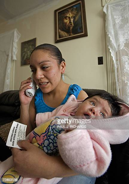 Margarita Ambriz from Villachuato Michoacan Mexico holds her 2yearold baby Janet and calls St Mary's Church for advice 19 December 2006 as she awaits...