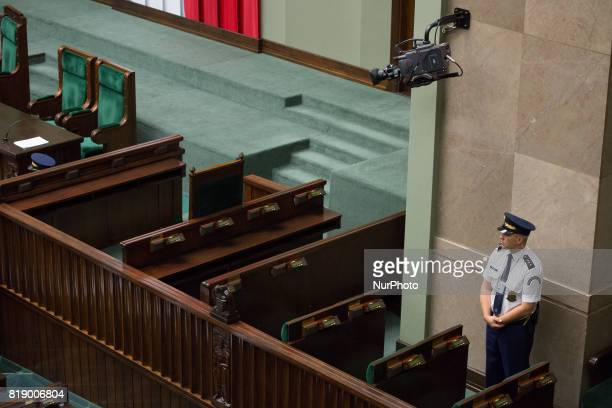 Marshals Guard watch the entrance to the rostrum during a night debate on a Supreme Court bill in the lower house of Polish Parliament in Warsaw...
