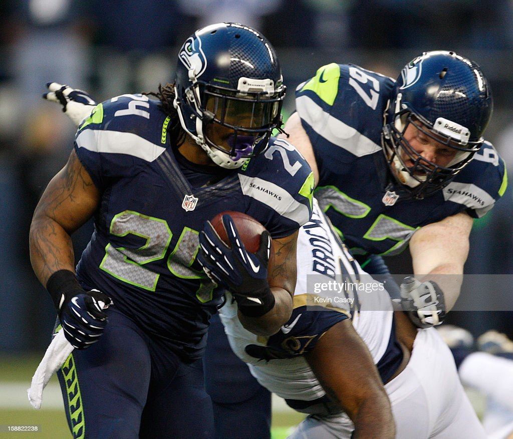 Marshawn Lynch #24 of Seattle Seahawks carries the ball in the first half against the St. Louis Rams at CenturyLink Field on December 30, 2012 in Seattle, Washington.