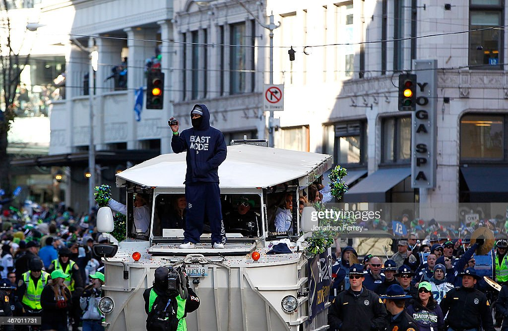 Marshawn Lynch #24 of Seattle Seahawks celebrates waves to fans during a parade to celebrate their victory in Super Bowl XLVII on February 5, 2014 in Seattle, Washington.