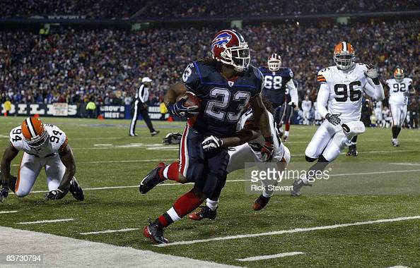 Marshawn Lynch of the Buffalo Bills runs as Terry Cousin of the Cleveland Browns comes in for the tackle November 17 2008 at Ralph Wilson Stadium in...