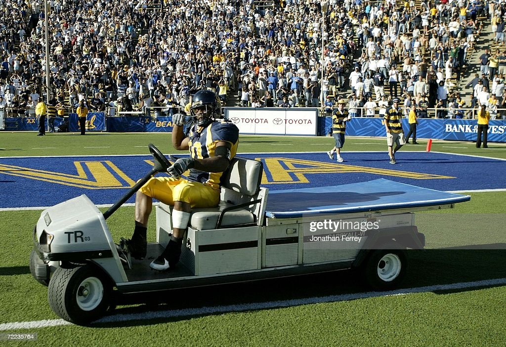 Marshawn Lynch of the California Golden Bears celebrates by driving a golf cart on the field after an interception by Desomond Bishop secured the...