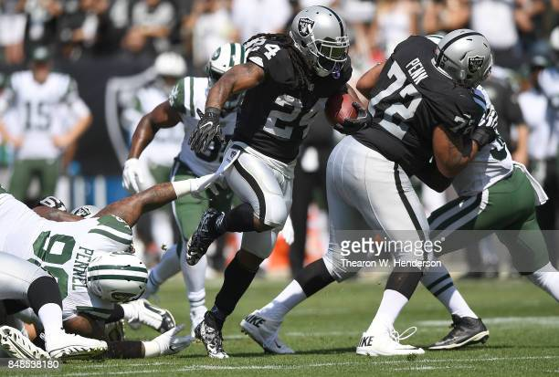 Marshawn Lynch of the Oakland Raiders breaks a tackle and rushes for a thirteen yard gain against the New York Jets during the first quarter of their...