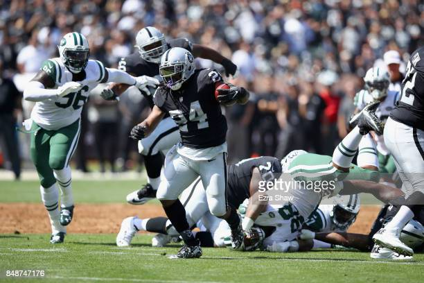 Marshawn Lynch of the Oakland Raiders runs with the ball against the New York Jets at OaklandAlameda County Coliseum on September 17 2017 in Oakland...