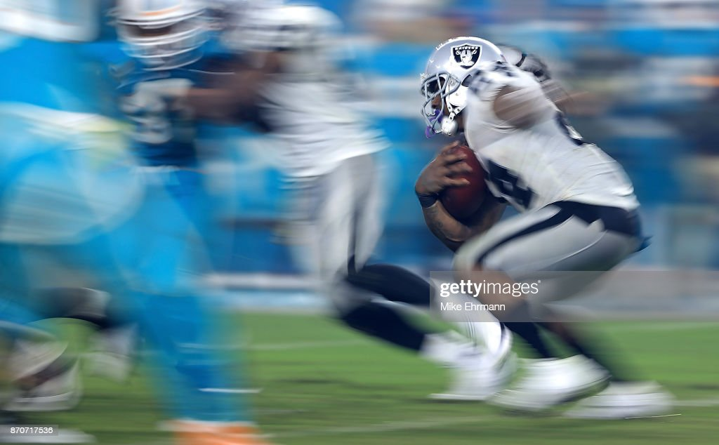 Marshawn Lynch #24 of the Oakland Raiders rushes during a game against the Miami Dolphins at Hard Rock Stadium on November 5, 2017 in Miami Gardens, Florida.