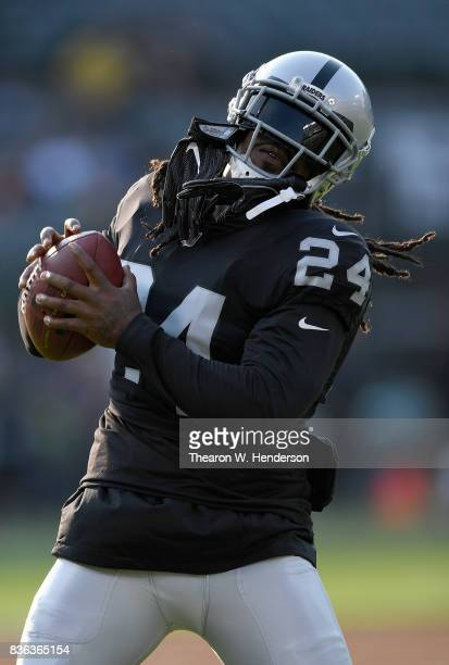 Marshawn Lynch of the Oakland Raiders warms up during pregame warm ups prior to playing the Los Angeles Rams in an NFL preseason football game at...