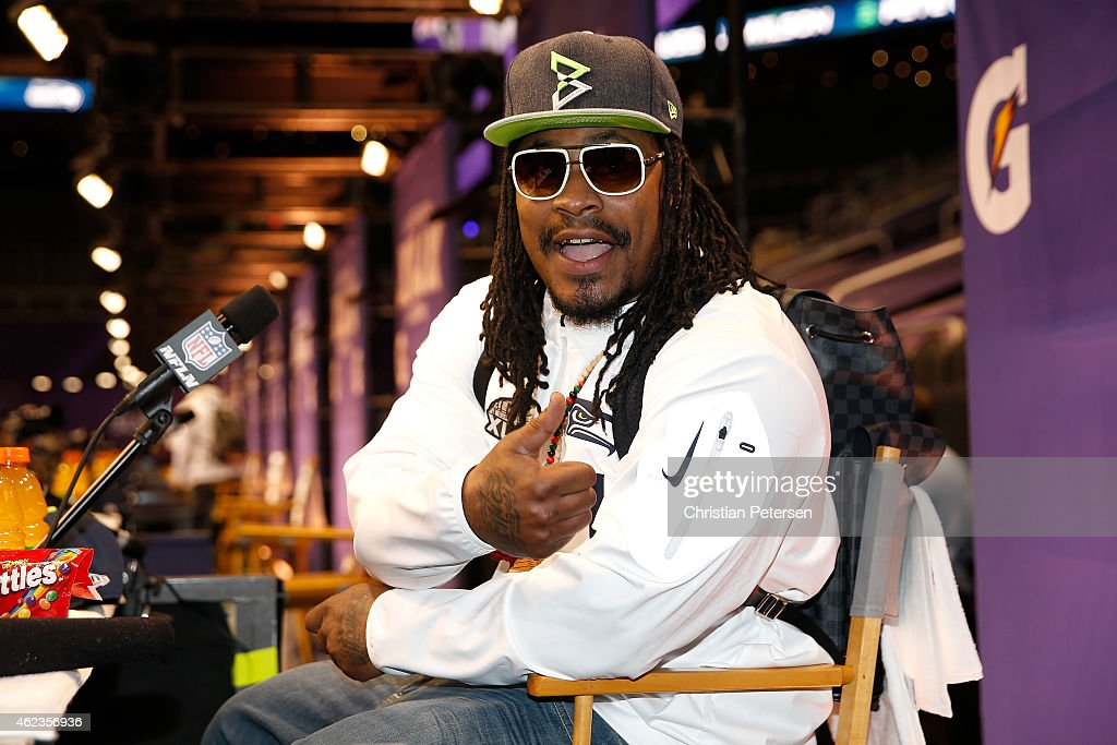 <a gi-track='captionPersonalityLinkClicked' href=/galleries/search?phrase=Marshawn+Lynch&family=editorial&specificpeople=2159904 ng-click='$event.stopPropagation()'>Marshawn Lynch</a> #24 of the Seattle Seahawks addresses the media at Super Bowl XLIX Media Day Fueled by Gatorade inside U.S. Airways Center on January 27, 2015 in Phoenix, Arizona.