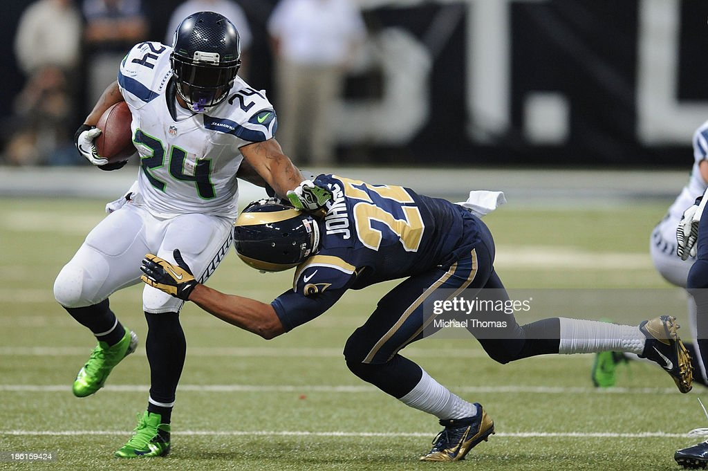 <a gi-track='captionPersonalityLinkClicked' href=/galleries/search?phrase=Marshawn+Lynch&family=editorial&specificpeople=2159904 ng-click='$event.stopPropagation()'>Marshawn Lynch</a> #24 of the Seattle Seahawks breaks the tackle of <a gi-track='captionPersonalityLinkClicked' href=/galleries/search?phrase=Trumaine+Johnson&family=editorial&specificpeople=3915425 ng-click='$event.stopPropagation()'>Trumaine Johnson</a> #22 of the St. Louis Rams in the fourth quarter at the Edward Jones Dome on October 28, 2013 in St. Louis, Missouri.