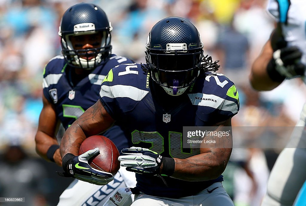 <a gi-track='captionPersonalityLinkClicked' href=/galleries/search?phrase=Marshawn+Lynch&family=editorial&specificpeople=2159904 ng-click='$event.stopPropagation()'>Marshawn Lynch</a> #24 of the Seattle Seahawks during their game at Bank of America Stadium on September 8, 2013 in Charlotte, North Carolina.