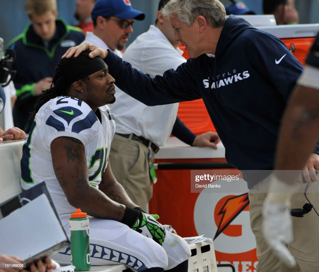 Marshawn Lynch #24 of the Seattle Seahawks is congratulated by head coach Pete Carroll after a touchdown against the Chicago Bears on December 2, 2012 at Soldier Field in Chicago, Illinois.The Seattle Seahawks defeated the Chicago Bears 23-17 in overtime.