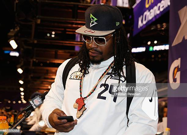 Marshawn Lynch of the Seattle Seahawks looks at his phone at Super Bowl XLIX Media Day Fueled by Gatorade inside US Airways Center on January 27 2015...