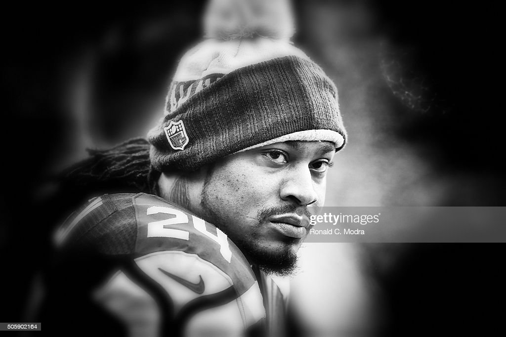 Marshawn Lynch #24 of the Seattle Seahawks looks on before the NFC Divisional Playoff Game against the Carolina Panthers at Bank of America Stadium on January 17, 2016 in Charlotte, North Carolina.