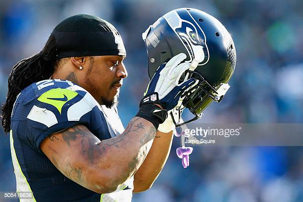 Marshawn Lynch of the Seattle Seahawks looks on during the third quarter of the NFC Divisional Playoff Game against the Carolina Panthers at Bank of...