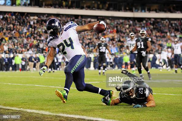 Marshawn Lynch of the Seattle Seahawks runs 15 yards for a touchdown against Nate Allen of the Philadelphia Eagles during the third quarter of the...