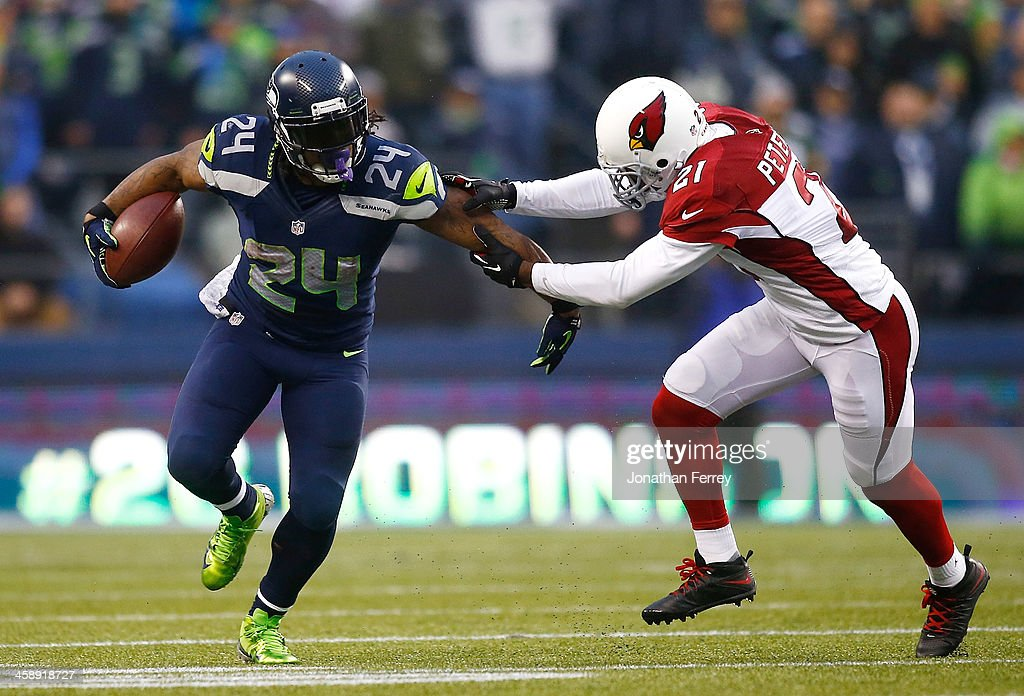 <a gi-track='captionPersonalityLinkClicked' href=/galleries/search?phrase=Marshawn+Lynch&family=editorial&specificpeople=2159904 ng-click='$event.stopPropagation()'>Marshawn Lynch</a> #24 of the Seattle Seahawks runs against <a gi-track='captionPersonalityLinkClicked' href=/galleries/search?phrase=Patrick+Peterson&family=editorial&specificpeople=5582456 ng-click='$event.stopPropagation()'>Patrick Peterson</a> #21 of the Arizona Cardinals on December 22, 2013 at CenturyLink Field in Seattle, Washington.