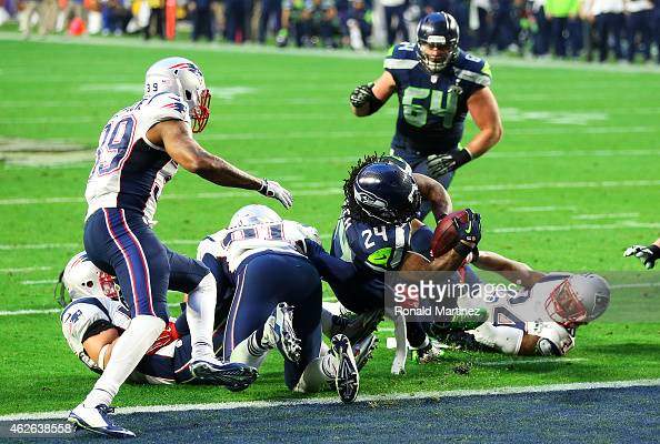 Marshawn Lynch of the Seattle Seahawks runs the ball in for a touchdown against the New England Patriots in the second quarter during Super Bowl XLIX...