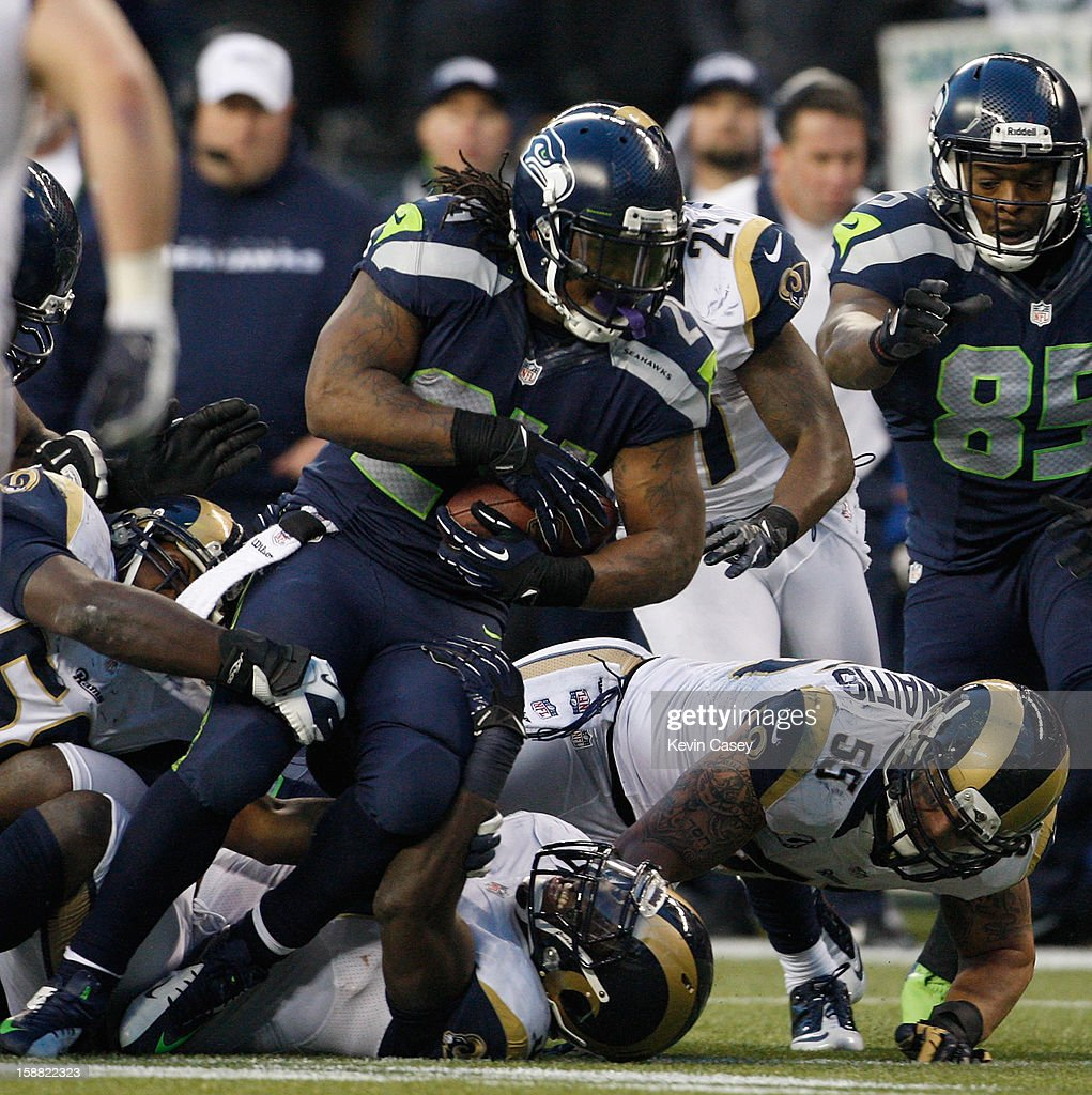 <a gi-track='captionPersonalityLinkClicked' href=/galleries/search?phrase=Marshawn+Lynch&family=editorial&specificpeople=2159904 ng-click='$event.stopPropagation()'>Marshawn Lynch</a> #24 of the Seattle Seahawks rushes against the defense of the St. Louis Rams in the second half at CenturyLink Field on December 30, 2012 in Seattle, Washington.