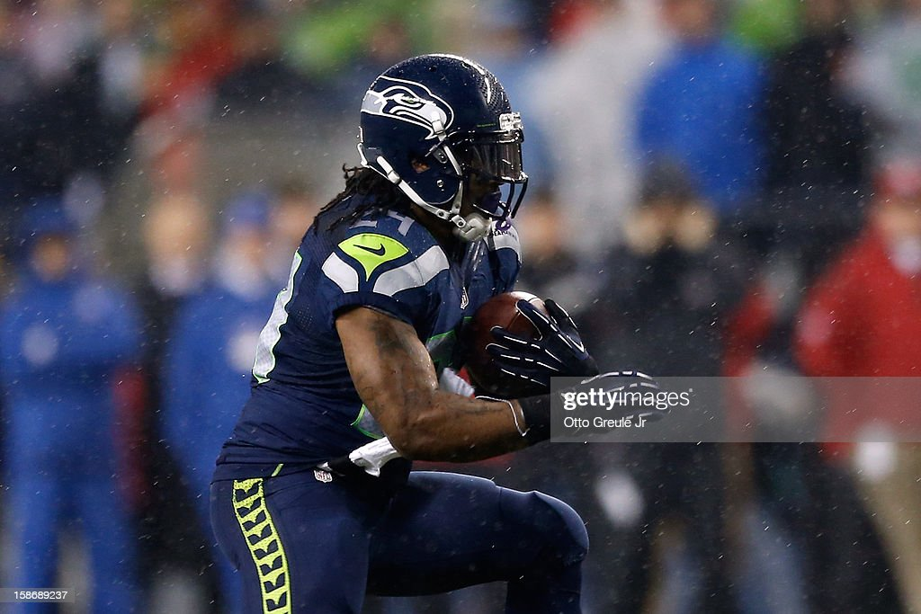 <a gi-track='captionPersonalityLinkClicked' href=/galleries/search?phrase=Marshawn+Lynch&family=editorial&specificpeople=2159904 ng-click='$event.stopPropagation()'>Marshawn Lynch</a> #24 of the Seattle Seahawks scores a 24-yard rushing touchdown in the first quarter against the San Francisco 49ers at Qwest Field on December 23, 2012 in Seattle, Washington.
