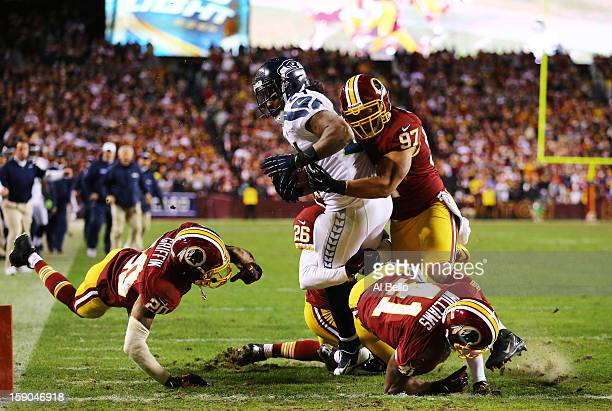 Marshawn Lynch of the Seattle Seahawks scores a fourth quarter touchdown against the defense of Lorenzo Alexander of the Washington Redskins during...