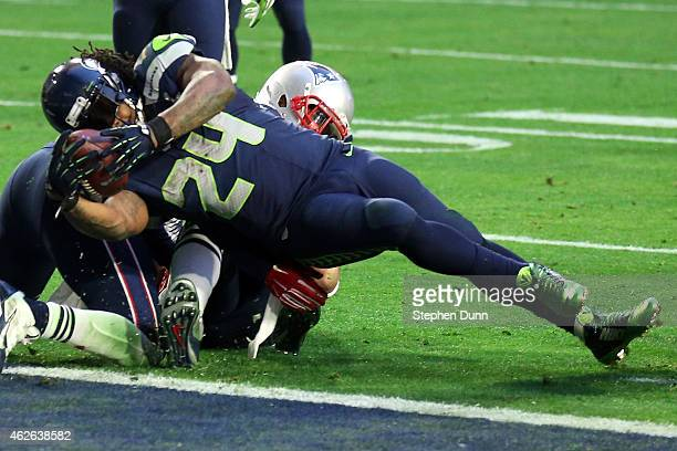 Marshawn Lynch of the Seattle Seahawks scores a three yard touchdown in the second quarter against the New England Patriots during Super Bowl XLIX at...
