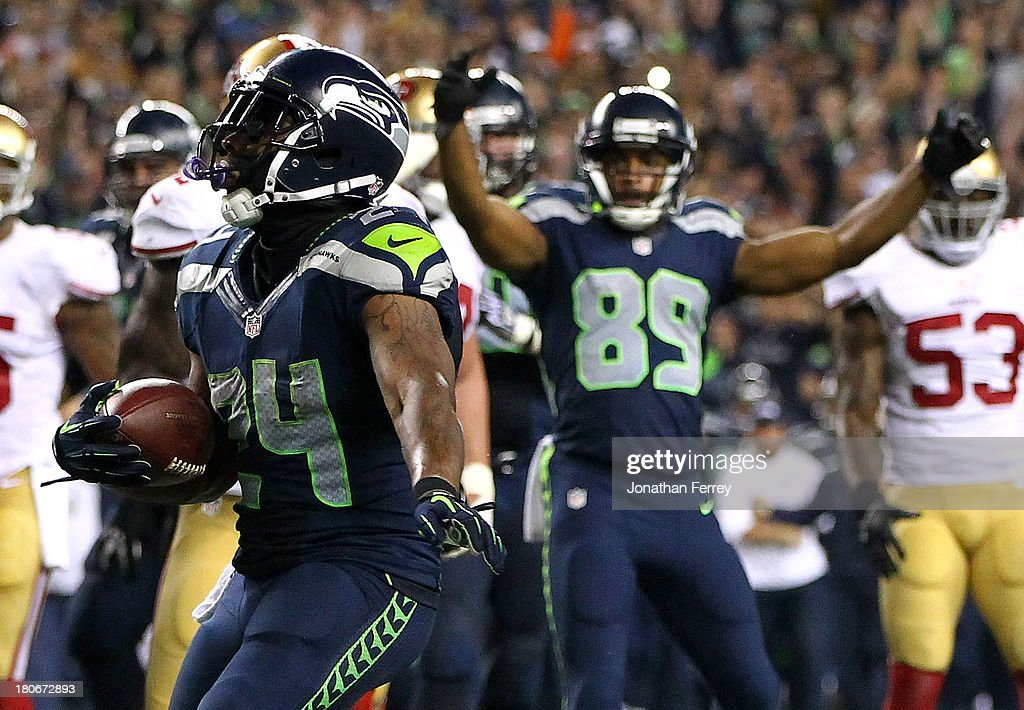 <a gi-track='captionPersonalityLinkClicked' href=/galleries/search?phrase=Marshawn+Lynch&family=editorial&specificpeople=2159904 ng-click='$event.stopPropagation()'>Marshawn Lynch</a> #24 of the Seattle Seahawks scores a touchdown against the San Francisco 49ers on September 15, 2013 at CenturyLink Field in Seattle, Washington.