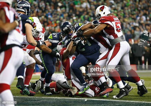 Marshawn Lynch of the Seattle Seahawks scores a touchdown during the fourth quarter against the Arizona Cardinals at CenturyLink Field on November 15...