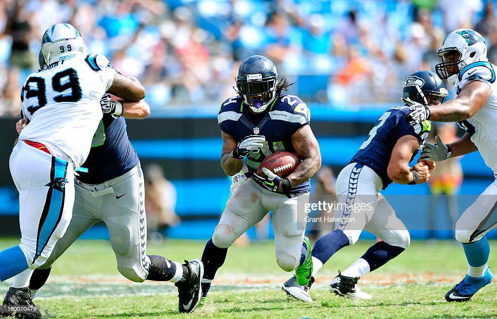 <a gi-track='captionPersonalityLinkClicked' href=/galleries/search?phrase=Marshawn+Lynch&family=editorial&specificpeople=2159904 ng-click='$event.stopPropagation()'>Marshawn Lynch</a> #24 of the Seattle Seahawks turns upfield against the Carolina Panthers during play at Bank of America Stadium on September 8, 2013 in Charlotte, North Carolina. Seattle won 12-7.