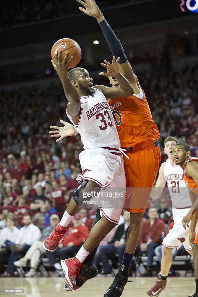 Marshawn Powell #33 of the Arkansas Razorbacks goes up for a shot over Asauhn Dixon-Tatum #0 of the Auburn Tigers at Bud Walton Arena on January 16, 2013 in Fayetteville, Arkansas.