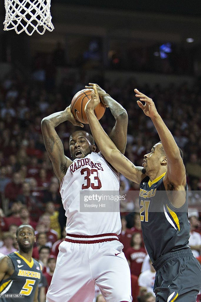 Marshawn Powell #33 of the Arkansas Razorbacks is fouled by Laurence Bowers #21 of the Missouri Tigers at Bud Walton Arena on February 16, 2013 in Fayetteville, Arkansas. The Razorbacks defeated the Tigers 73-71.