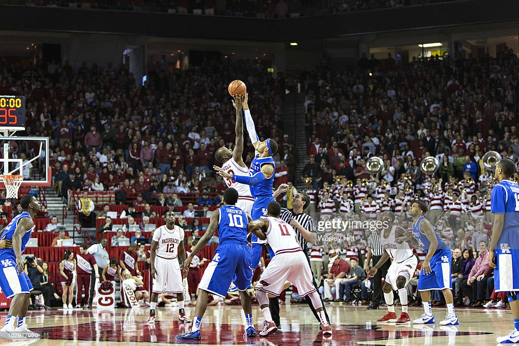Marshawn Powell #33 of the Arkansas Razorbacks jumps for the opening tip off against Willie Cauley-Stein #15 of the Kentucky Wildcats at Bud Walton Arena on March 2, 2013 in Fayetteville, Arkansas. The Razorbacks defeated the Wildcats 73-60.