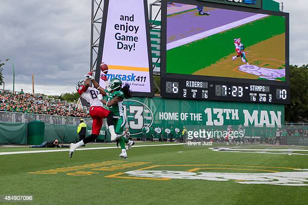 Marshay Green of the Saskatchewan Roughriders breaks up and intercepts a pass intended for Eric Rogers of the Calgary Stampeders in the end zone on a...