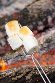 Marshmallows being toasted over