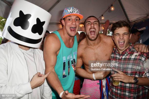 Marshmello New England Patriots tight end Rob Gronkowski Mojo Rawley and Martin Garrix attend the SiriusXM Music Lounge at 1 Hotel South Beach on...